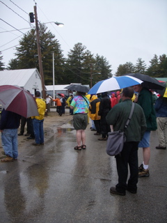 Umbrellas are required gear for the final raffle drawing.